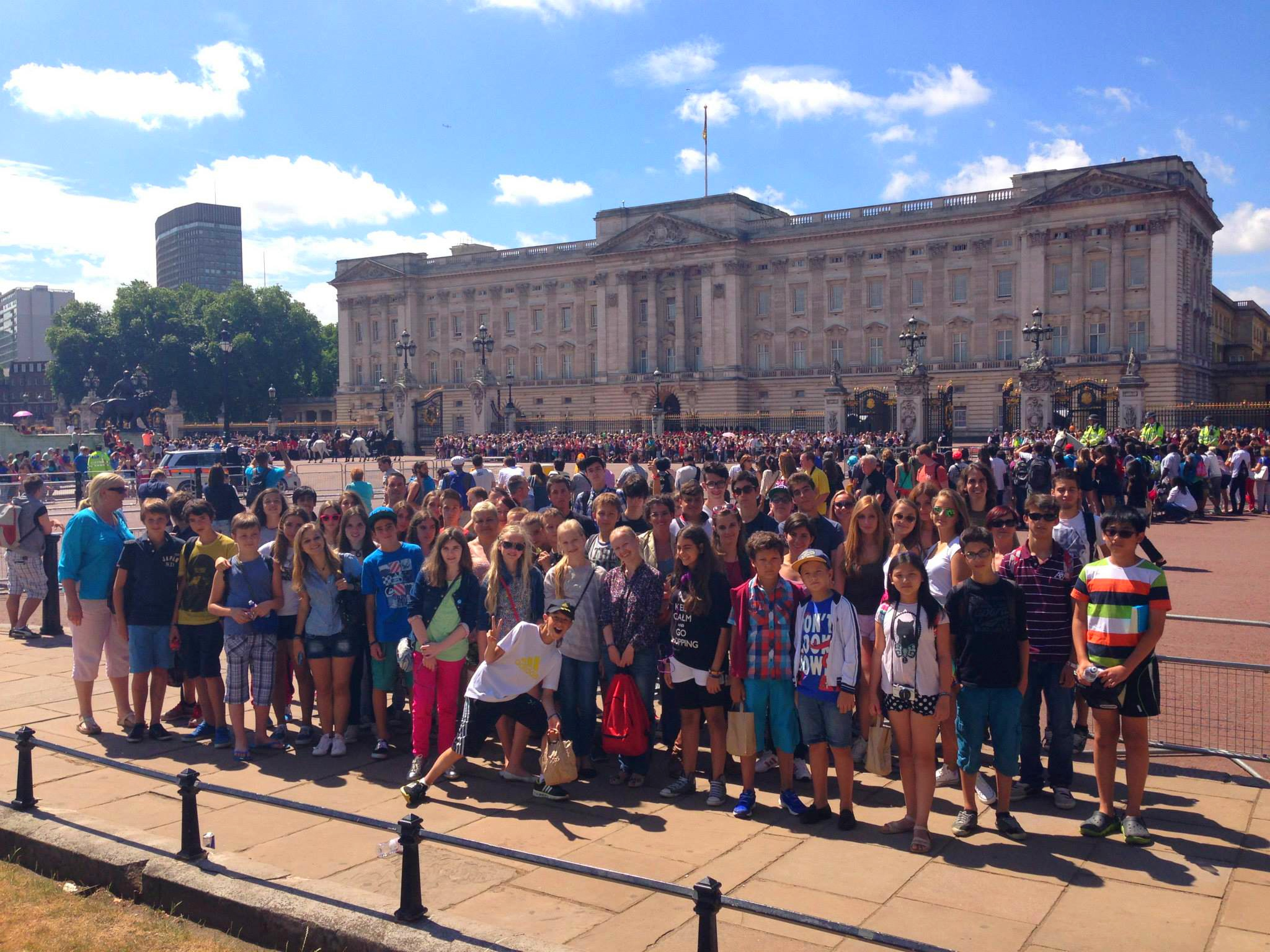 group of summer programme students outside buckingham palace in london. teacher training can join this as well